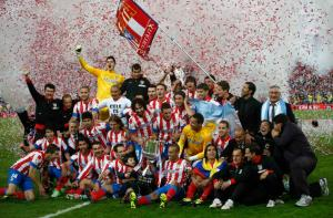 Atletico Madrid players celebrate victory against Real Madrid after Spanish King's Cup final soccer match in Madrid
